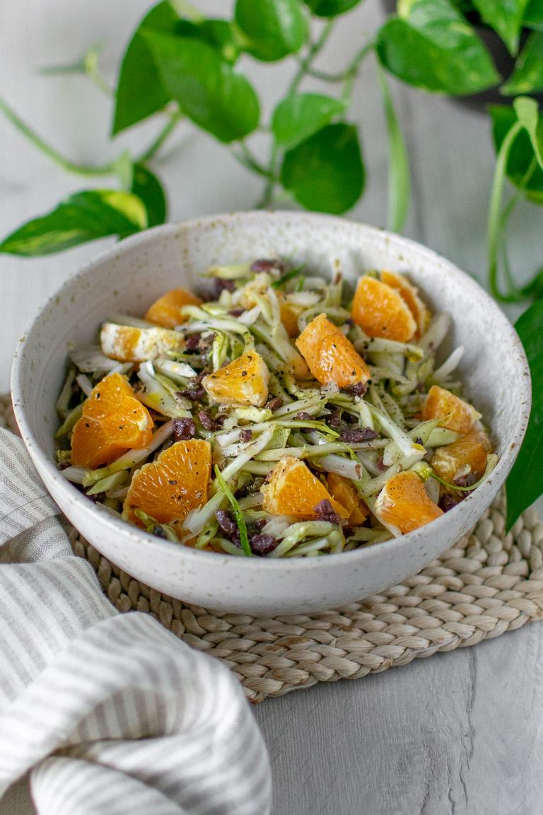 insalata di puntarelle, olive taggiasche, capperi, noci e arancio